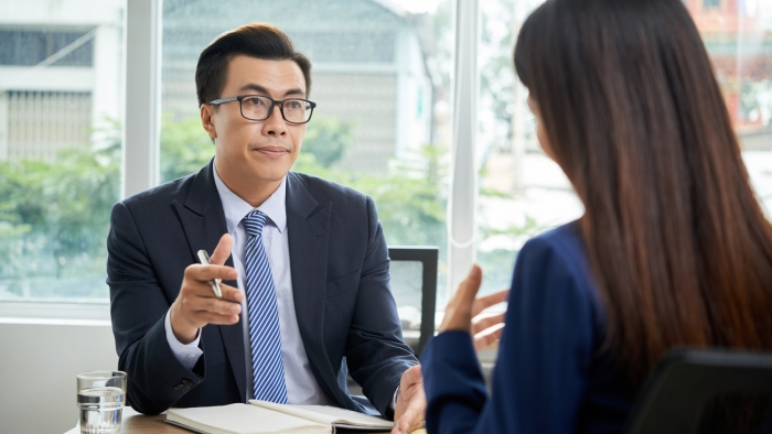 Investor discussing business project with coworker